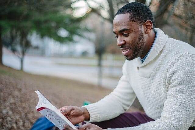 black male reading a book